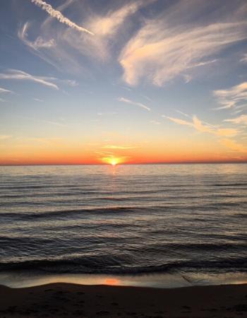 Sunset over dark water