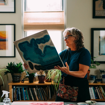 Mary Brodbeck holds a woodblock in her studio